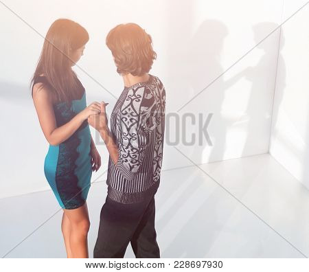 young couple standing in an empty room.