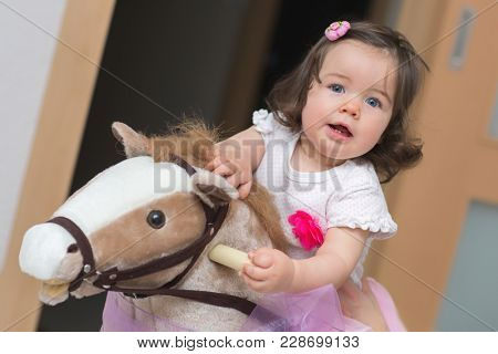 Year-old baby girl on rocking horse