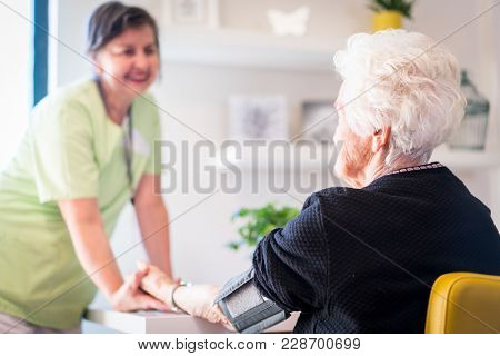 Elderly woman needs care of medical nurse