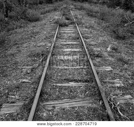Old, Unused Railroad Track Going Nowhere In Canada