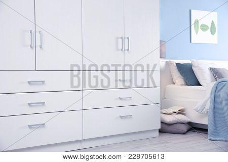 Room interior with large wardrobe closet