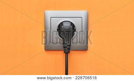 Electric outlet with cable connected