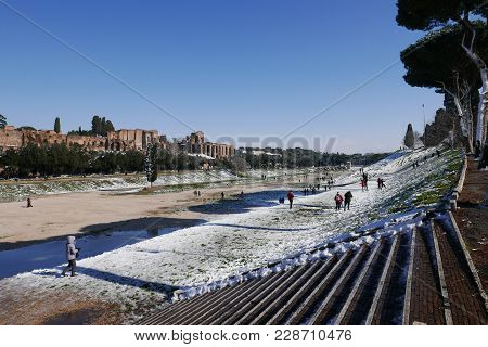 Rome, Italy -  February 26, 2018: People In The Circo Massimo, Romans Enjoy The First Snow In Years