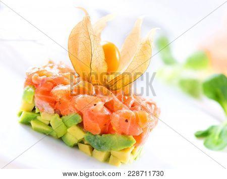Salmon Tartar over White Background. Gourmet Food. Starter. Healthy dinner.