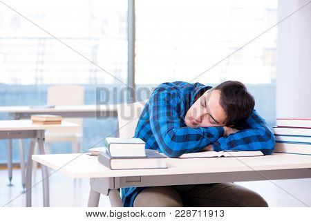 Student studying in the empty library with book preparing for ex