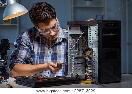 Man repairing computer desktop with pliers