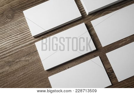 Photo Of Blank Business Cards On Wood Background. For Design Presentations And Portfolios. Top View.