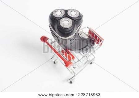 Shopping Cart Trolly With Electric Razor Shaver Isolated On White