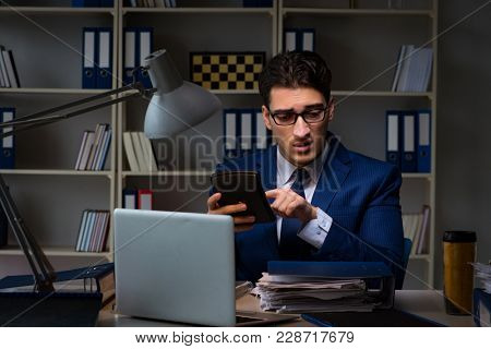 Auditor checking the accuracy of financial statements with calculator
