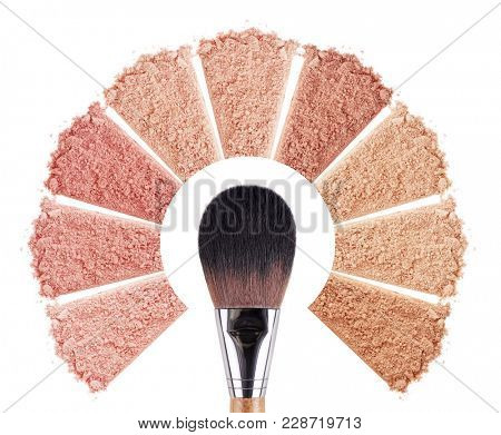 Smears of foundation for face. Conceptual flower from powder smears with a brush. Isolated on white background