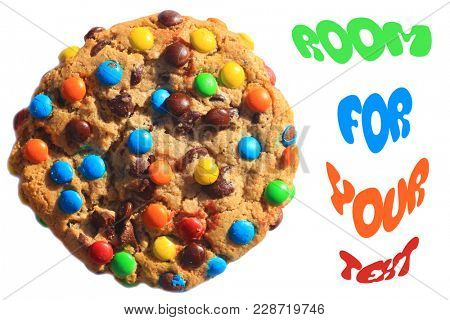 Cookie isolated on white with room for text. colorful candy coated chocolate drops in a delicious cookie with room for text or clipping path.