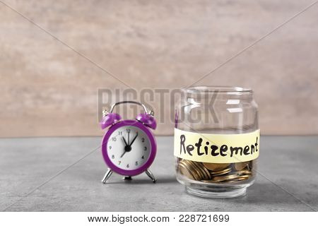 Coins in glass jar with label
