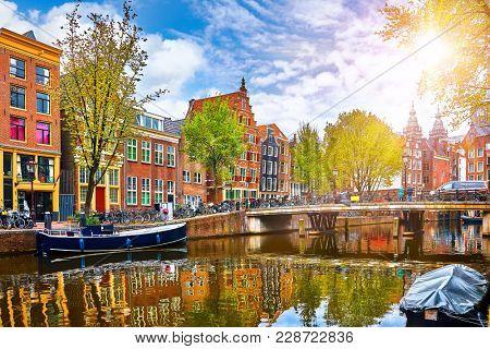 Channel in Amsterdam Netherlands houses river Amstel landmark old european city spring landscape.