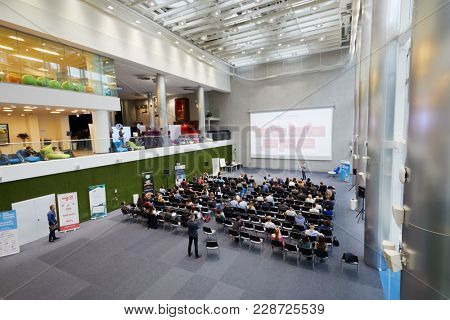 MOSCOW, RUSSIA - SEP 30, 2017: Auditorium in building of Headquarters Mail.Ru Group during conference Day of Internet Advertising with people participants listening to speaker.