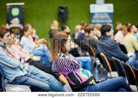 MOSCOW, RUSSIA - SEP 30, 2017: People listen to speaker in auditorium of Headquarters Mail.Ru Group during conference Day of Internet Advertising.