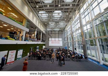 MOSCOW, RUSSIA - SEP 30, 2017: Auditorium of Headquarters Mail.Ru Group during conference Day of Internet Advertising with people participants listening to speaker.