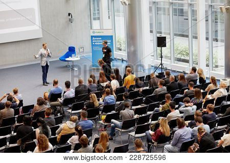 MOSCOW, RUSSIA - SEP 30, 2017: People participants listening to speaker in auditorium in building of Headquarters Mail.Ru Group during conference Day of Internet Advertising.