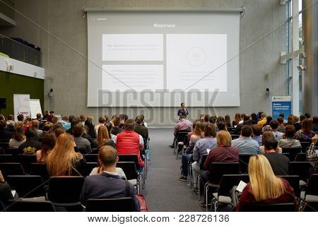 MOSCOW, RUSSIA - SEP 30, 2017: Participants of conference Day of Internet Advertising listen to speaker in auditorium of Headquarters Mail.Ru Group.