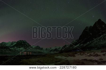 Green Northern Light (aurora Borealis) In A Clear Starry Night Above A Norwegian Fjord, Tromsø, Norw