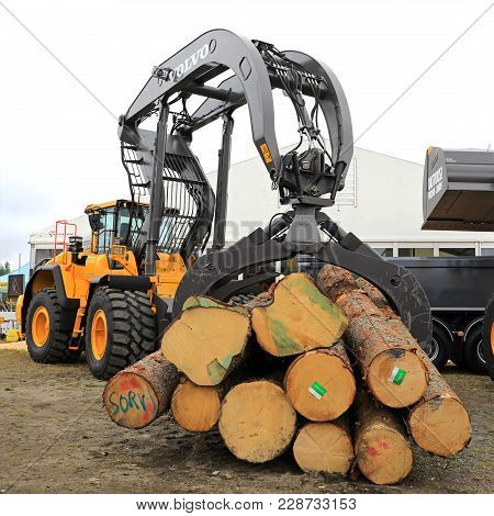 Hyvinkaa, Finland - September 8, 2017: Volvo Wheel Loader With Large Grapples Full Of Timber Logs.