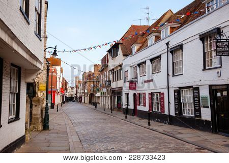 CANTERBURY, UK - JUN 1, 2013: Empty street at Old Town in the morning. Canterbury is a historic English cathedral city and UNESCO World Heritage Site