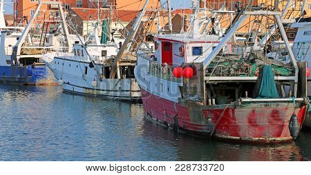 Red Fishing Boat In The Waterway With Many Others Boats