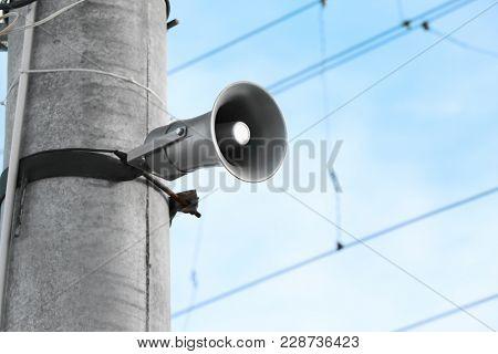 Megaphone on pole outdoors