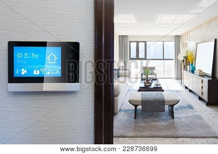 smart home system on intelligence screen on wall and background of modern living room