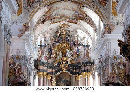 AMORBACH, GERMANY - JULY 08: Holy Trinity, Main altar in Amorbach Benedictine monastery church in Lower Franconia, Bavaria, Germany on July 08, 2017.