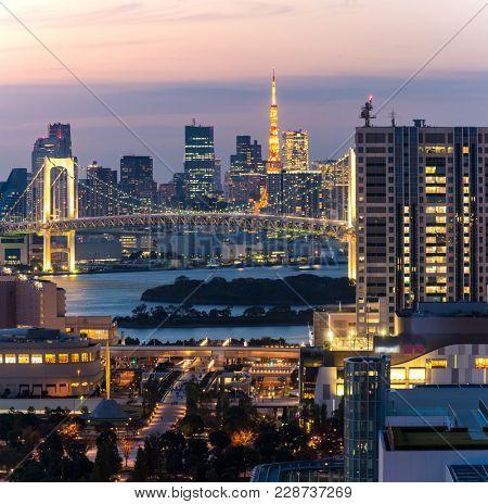 Tokyo skylines building with Tokyo tower and rainbow bridge in Tokyo, Japan.
