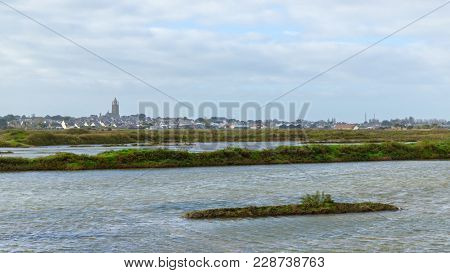 Batz-sur-Mer as seen from Guérande salt marshes in France
