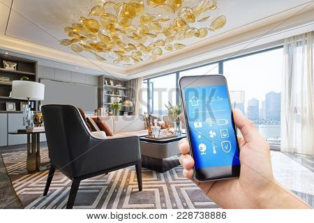 smart home system on mobile phone with background of modern living room