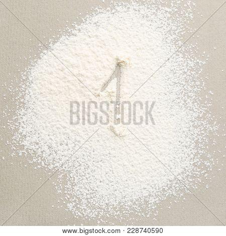 Figure ONE written on flour
