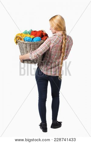 Back view of woman with  basket of dirty laundry. girl is engaged in washing. Rear view people collection.  backside view of person.   Girl with braided hair in a braid holding a laundry basket.