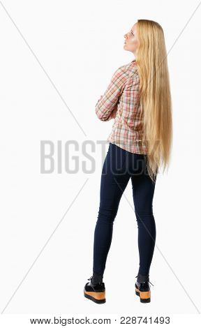 back view of standing young beautiful  woman.  girl  watching. Rear view people collection.  backside view of person.  Girl with very long hair looking ahead.