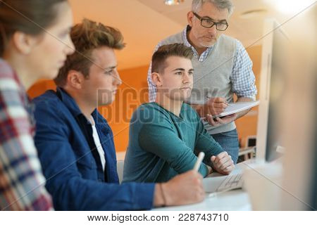 Teacher controlling students work in class
