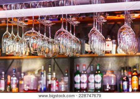 Different Glasses Hanging Over The Bar. Soft Focus. Selective Focus