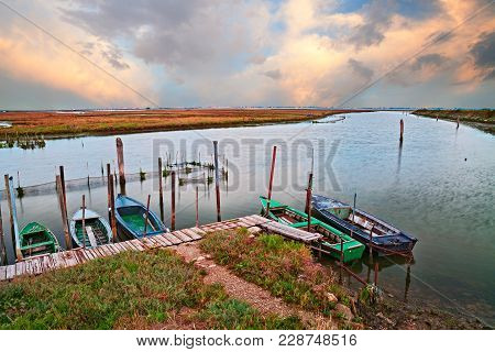 Chioggia, Venice, Veneto, Italy: Picturesque Landscape At Sunset Of The Lagoon Next To The Town With