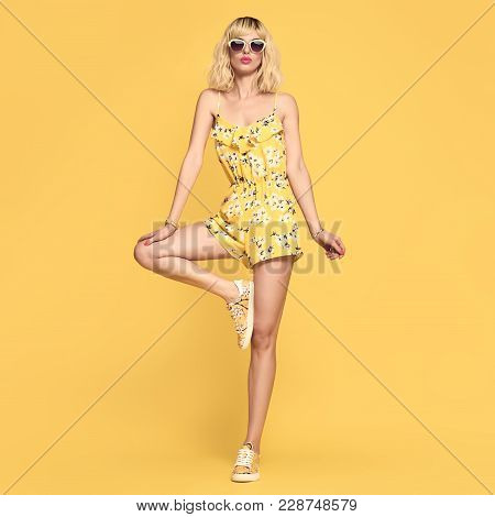 Fashionable Female Blond Model, Trendy Sunglasses. Stylish Glamour Summer Yellow Fashion Outfit. You
