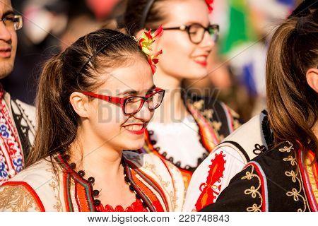 Pernik, Bulgaria - January 26, 2018: Beautiful Dancer In Traditional Folklore Bulgarian Costume Smil