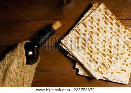 Traditional Jewish Kosher Matzo For Easter Pesah On A Wooden Table. Jewish Easter Food. Spring.matzo