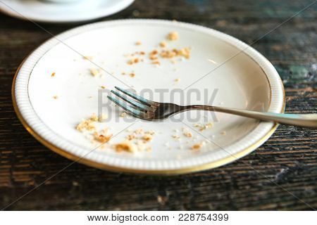 Conceptual Image Of The End Of The Holiday Is An Empty Plate With Crumbs And A Fork On It