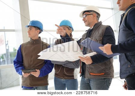 Instructor with young people in engineering training