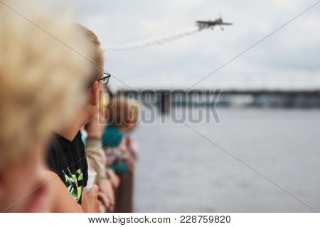 People Are Watching The Air Show On The Coast Of The River