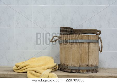 Old Sauna Accessories On A Wooden Bench In A Finnish Sauna
