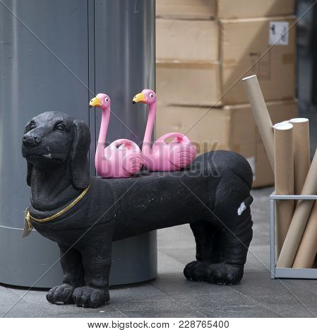 London, England - September 11, 2017 Pink Plastic Flamingos On A Black Plastic Basset At The Entranc