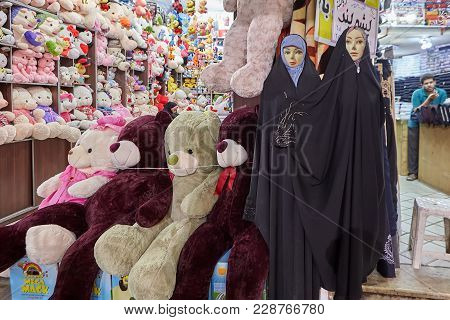 Kashan, Iran - April 25, 2017: Department With Toys Of Animals - Large Bears, And Dolls In Hijabs In