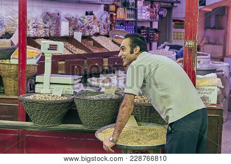 Kashan, Iran - April 25, 2017: Iranian Grocer Stands And Smiles At A Grocery Store In The Eastern Ba