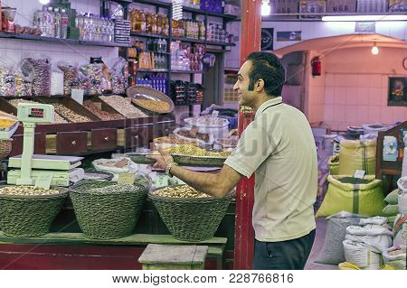 Kashan, Iran - April 25, 2017: Iranian Grocer Stands In The Grocery Department In The Eastern Market