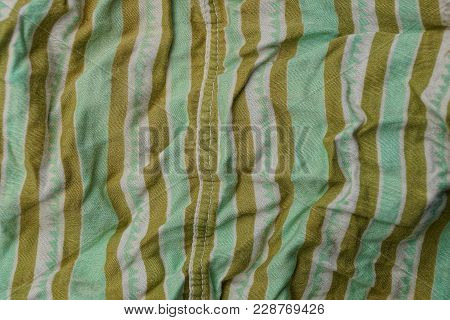 Green Brown Fabric Texture From A Piece Of Crumpled Clothes